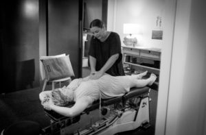 A pregnancy chiropractor helping a woman in Brisbane